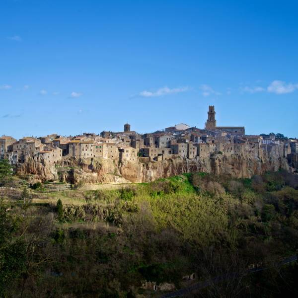 A ray of sun lighting Pitigliano a medieval town on tufa rocks situated in maremma tuscany italy